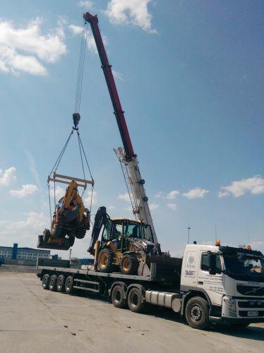 Loading equipment on barge